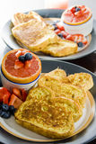 Breakfast for two. Close-up on a breakfast of french toast and grapefruit Royalty Free Stock Photos