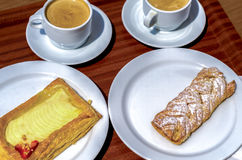 Breakfast. Two pastries and two cups of coffee on a tray stock photo