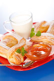 Breakfast: two peach cakes, milk and jam on plate Royalty Free Stock Photos