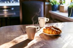Breakfast for two person with cup of hot coffee and fresh croiss. Ants Royalty Free Stock Photo