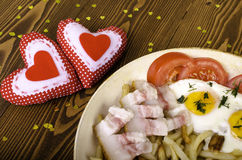 Breakfast for two on Valentine's Day. Frying pan with a meal and Stock Image