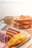 Breakfast on vacation riverside resort. Stock Image