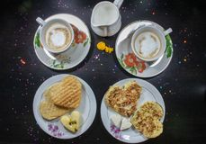 Breakfast on Valentine`s Day - fried omelete, bread, apple and White cheese in the shape of a heart coffe and milk. Top view royalty free stock photography