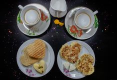 Breakfast on Valentine`s Day - fried omelete, bread, apple and White cheese in the shape of a heart coffe and milk. Top view. Breakfast on Valentine`s Day stock photo