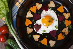 Breakfast on Valentine's Day of  hearts eggs and vegetables Royalty Free Stock Image