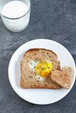 Breakfast on Valentine`s Day. Breakfast Valentine`s Day. On the plate is toast with fried eggs inside a heart and orange juice Stock Photography
