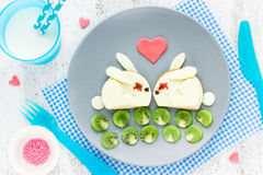 Breakfast on Valentines Day funny sandwich shaped cute white bun Stock Photos