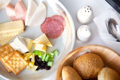 Breakfast with various of breads, cheese, ham, crakers, salami a royalty free stock images