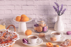 Breakfast with various macaroons, croissants and hot chocolate. Stock Photos