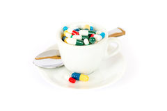 Breakfast with various pills Stock Images