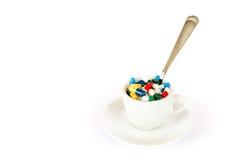 Breakfast with various pills Stock Photos