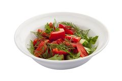 Breakfast. Vegetable salad with tomato and cucumber. On a white background royalty free stock image