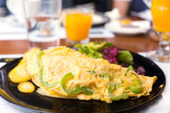 Breakfast with vegetarian omelet Stock Photo
