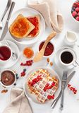 Breakfast with waffle, toast, berry, jam, chocolate spread and. Coffee. Top view Royalty Free Stock Images