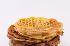 Breakfast Waffles. Accumulated over one another waffle on a white background royalty free stock photo