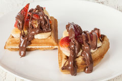 Breakfast waffles with chocolate cream and strawberries royalty free stock photography