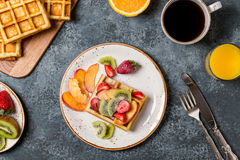 Breakfast waffles with fresh fruit. Royalty Free Stock Images