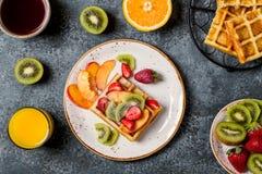 Breakfast waffles with fresh fruit. Royalty Free Stock Image