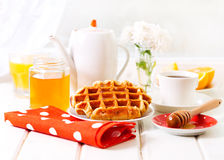 Breakfast with waffles, honey and coffee Stock Photo