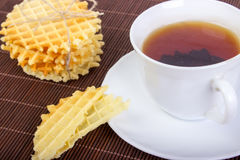 Breakfast with Waffles, Pieces of Waffle and Black Cup of Tea on Wooden Surface Royalty Free Stock Photos