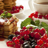 Breakfast - waffles with syrup and berries Stock Images