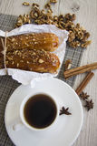 Breakfast with walnuts and eclairs Stock Images