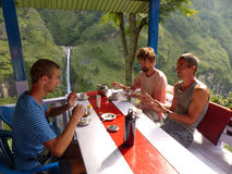 Breakfast with waterfall view - Chyamche village. Marsyangdi river valley - Annapurna Circuit trek in Nepal royalty free stock photos