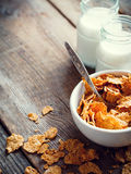 Breakfast  wheat flakes in bowl and milk bottles on wooden Stock Images