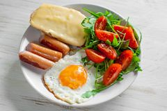 Breakfast which includes eggs, sausages, salad and toast. With cheese Royalty Free Stock Photography