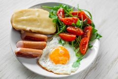 Breakfast which includes eggs, sausages, salad and toast. With cheese Royalty Free Stock Photo