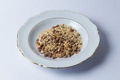 Breakfast. White plate of chocolate muesli Stock Image