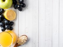 Breakfast on a White Table Coffee Croissant Orange juice Grapes Apple Chocolate Copy Space for Text. Breakfast on a White Table Coffee Croissant Orange juice Royalty Free Stock Images