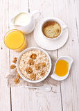 Breakfast on a white wooden table. Royalty Free Stock Photo