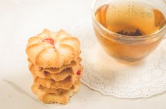 Breakfast whith cookies and glass cup whith tea/Breakfast whith cookies and glass cup whith tea on a white background. Focus on. Cookies stock image