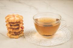 Breakfast whith cookies and glass cup whith tea/Breakfast whith cookies and glass cup whith tea on a white table. Selective focus. Sweet hot pastry food bakery royalty free stock photography