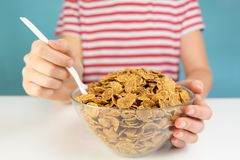 Breakfast with whole grain cereals concept. Illustrative minimal. Istic image of healthy vegetarian food on the table and hungry person stock images