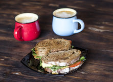 Breakfast, Whole wheat Sandwiches and coffee for two on wooden table Royalty Free Stock Images