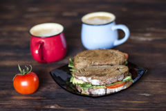 Breakfast, Whole wheat Sandwiches, tomato and coffee for two on wooden table Stock Image