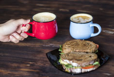 Breakfast, Whole wheat Sandwiches, tomato and coffee for two on wooden table Stock Images