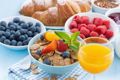 Breakfast with wholegrain flakes fruits and berries Royalty Free Stock Images