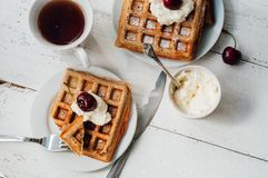 Breakfast with wholegrain waffles and whipped cream Royalty Free Stock Photography