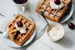 Breakfast with wholegrain waffles and whipped cream Stock Images
