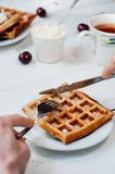 Breakfast with wholegrain waffles and whipped cream Stock Photo