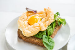 Breakfast with Wholemeal Bread Toast and Cloud Egg. Healthy Breakfast with Wholemeal Bread Toast and Cloud Egg with Green Salad and Avocado. Egg in Clouds is an Stock Images