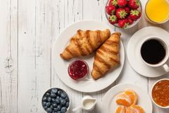 Free Breakfast With Croissants, Coffee, Jams And Berries Stock Photography - 123396752
