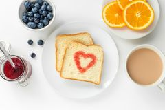 Free Breakfast With Cup Of Tea, Slice Orange, Toast Heart Of Berry Jam, Blueberry Stock Image - 157915571
