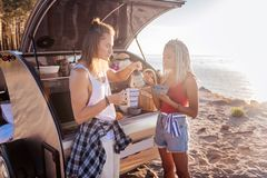 Blonde-haired man making tea having breakfast with his woman stock photo