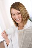 Breakfast - woman reading newspaper drink coffee Stock Images