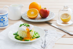 Breakfast on wooden background. Poached egg on rice - breakfast on wooden background Royalty Free Stock Photo
