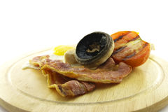 Breakfast on a Wooden Plate Royalty Free Stock Image